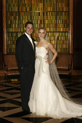 Bride and groom at Peninsula Chicago in formal attire