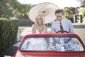Bride and groom in personalized golf cart