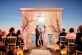 ca' d'van outdoor wedding ceremony at night overlooking sarasota bay