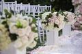wedding ceremony lacquer white aisle flower arrangements pink rose ivory rose white hydrangea