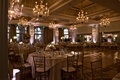 Chandeliers and gobo light names on dance floor round tables pretty ballroom wedding Casa Del Mar