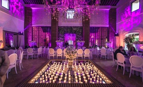 purple pink lighting mirror center candles destination wedding morocco opulent modern traditional