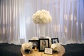 Family late loved ones table at reception with old photos, white flowers, and if heaven signage