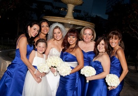Bride and flower girl with six bridesmaids