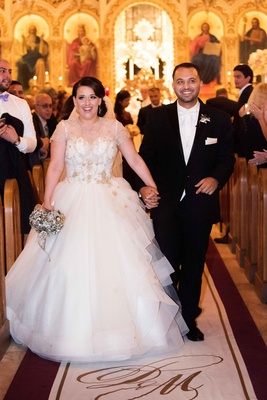 Bride in Lazaro wedding dress at ceremony aisle with custom Original Runner Company aisle runner