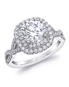 Cushion shaped double halo ring with twisted diamond shank