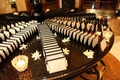 Wedding place card table with black and white cards, white flowers, and candles