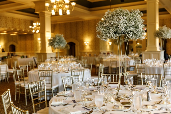 wedding with ivory and gold color scheme, baby's breath centerpiece