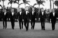 black and white photo of wedding party groomsmen tuxedo bow tie palm beach palm trees