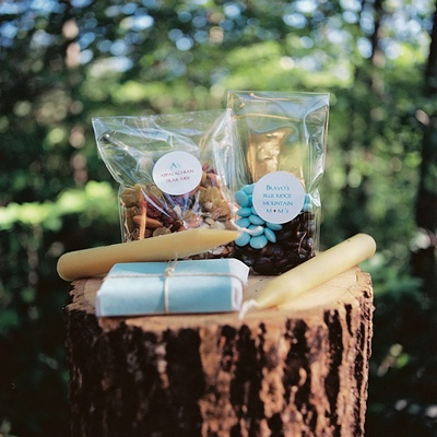Blue and brown goodie bag items on tree trunk