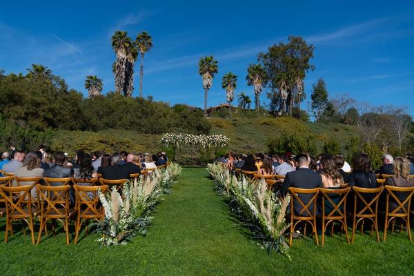 Echosmith singer Sydney Sierota and Cameron Quiseng outdoor wedding ceremony pampas grass vineyard