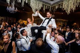wedding reception hora dance jewish wedding traditions reception reem acra wedding dress groom white