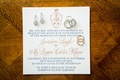 Bahamas destination wedding incitation calligraphy rose gold navy blue crest custom monogram