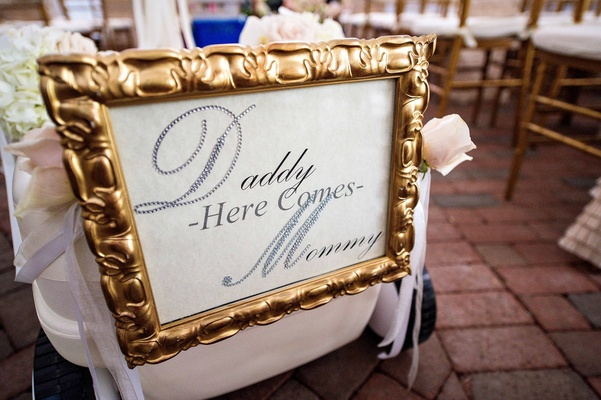 "Tracy Morgan and Megan Wollover wedding sign reading ""Daddy Here Comes Mommy"""