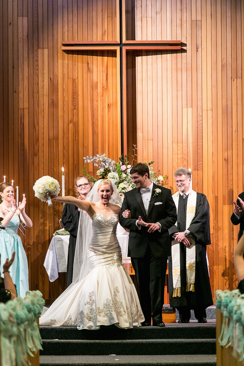 Woman in wedding dress and man in tuxedo in church