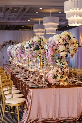 Wedding reception styled shoot inspiration metallic linens tall flower arrangements chandeliers gold