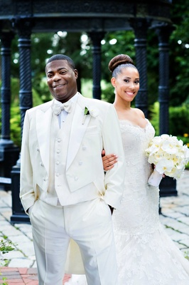Tracy Morgan in white tail tuxedo and Megan Wollover in Ines Di Santo wedding dress white bouquet