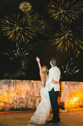 wedding reception firework show colombia wedding couple watching fireworks bride groom