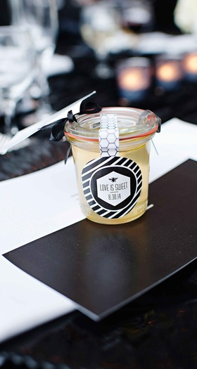 Jar of honey wedding favor and escort card with label