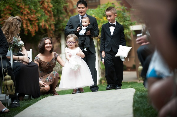 Baby ring bearer and little girl in glasses