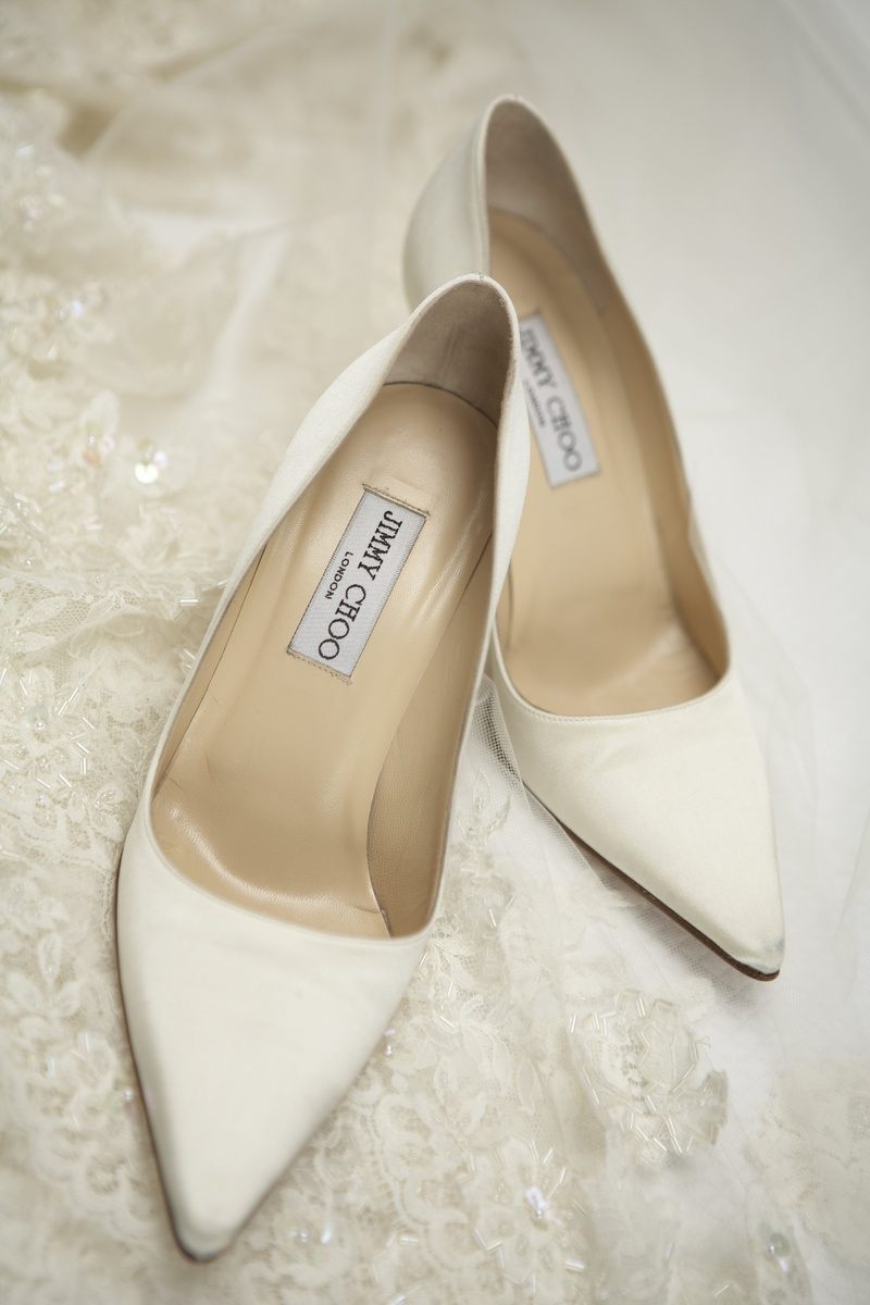 73f6e44e6c1 Shoes & Bags Photos - White Jimmy Choo Pumps - Inside Weddings