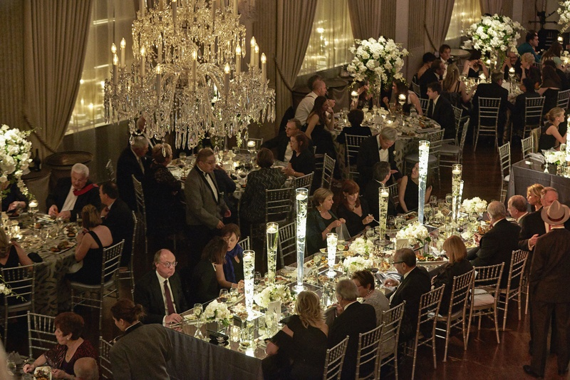 Bird's-eye view of guests eating at dinner service
