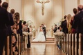bride and groom share first kiss at traditional church catholic wedding ceremony dallas texas