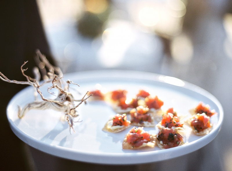 Tray passed hors d'oeuvres with rustic garnish
