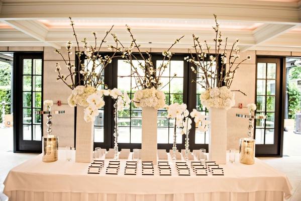 Cherry blossom branch white orchid white hydrangea escort card table