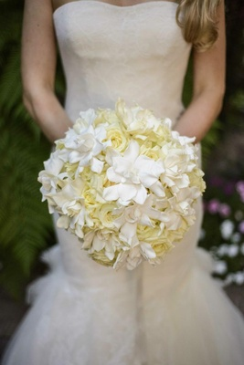 Bride carrying ivory roses and white gardenias