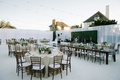 oceanside california reception space white green wood details fairy lights stage sheer curtains