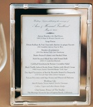 White and black menu in silver frame