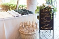 Wedding ceremony outdoor ideas sunglasses parasols in basket and other favors