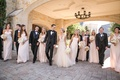 Bridesmaids and groomsmen walk with couple at Dallas Country Club venue