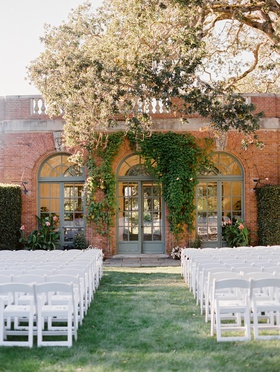 wedding at filoli, ceremony in front of brick building covered in ivy