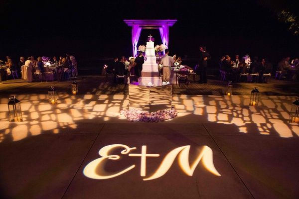 Gobo lighting dance floor projection at poolside wedding