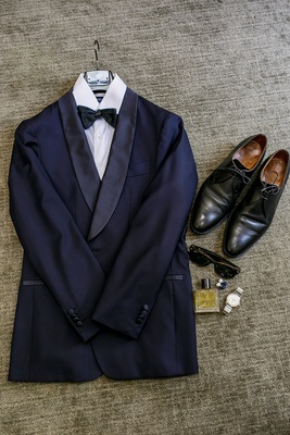 groom's navy tuxedo, dress shoes, sunglasses, cologne, watch, cuff links