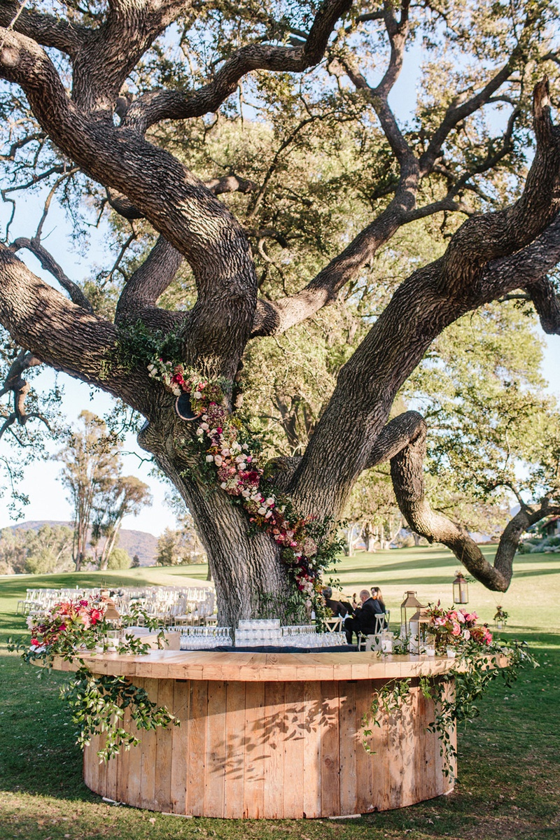 ojai valley inn wedding, bar around tree with flowers