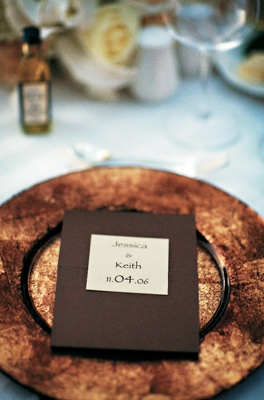 Wedding menu on top of golden charger plate