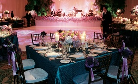 Reception tables surround dance floor and wedding band