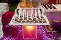 Purple sequin dessert table with tray of chocolate cake pops