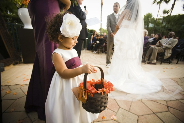 African American flower girl with white flower headpiece
