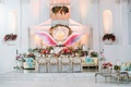 reception tablescape pink purple blue gold wings white lounge area