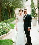 Bride in marchesa wedding dress illusion neckline short sleeve fit and flare groom in tuxedo bow tie