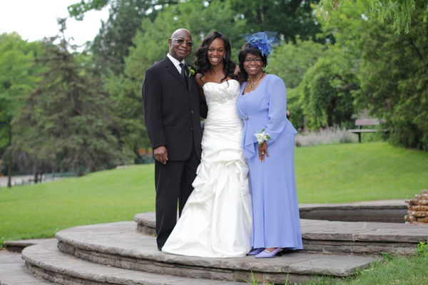 Enuka Okuma's mother of bride perriwinkle dress and hat