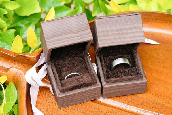 Silver platinum wedding band in brown ring box