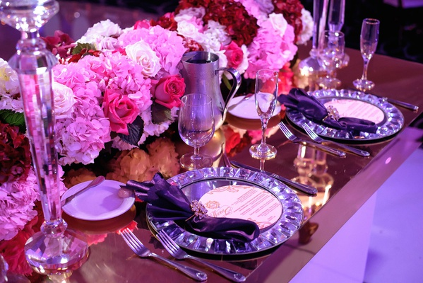 wedding reception place setting pink red hydrangea rose flowers crystal napkin ring and plate mirror