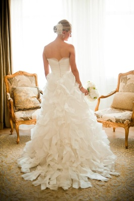 Strapless bridal gown with ruffled skirt on blonde bride