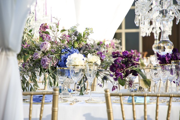 destination wedding in tuscany, purple, blue, and white flowers for centerpieces
