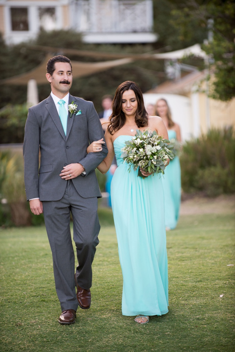 bridesmaid and groomsmen in baby blue dress and tie beach wedding